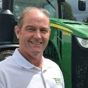 picture of Danny Marbury next to a 8295r tractor