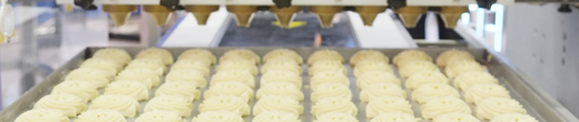 Large machinery demonstrating cupcakes being packaged
