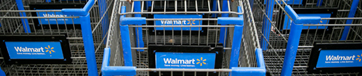 Stacked walmart carts displaying the walmart logo