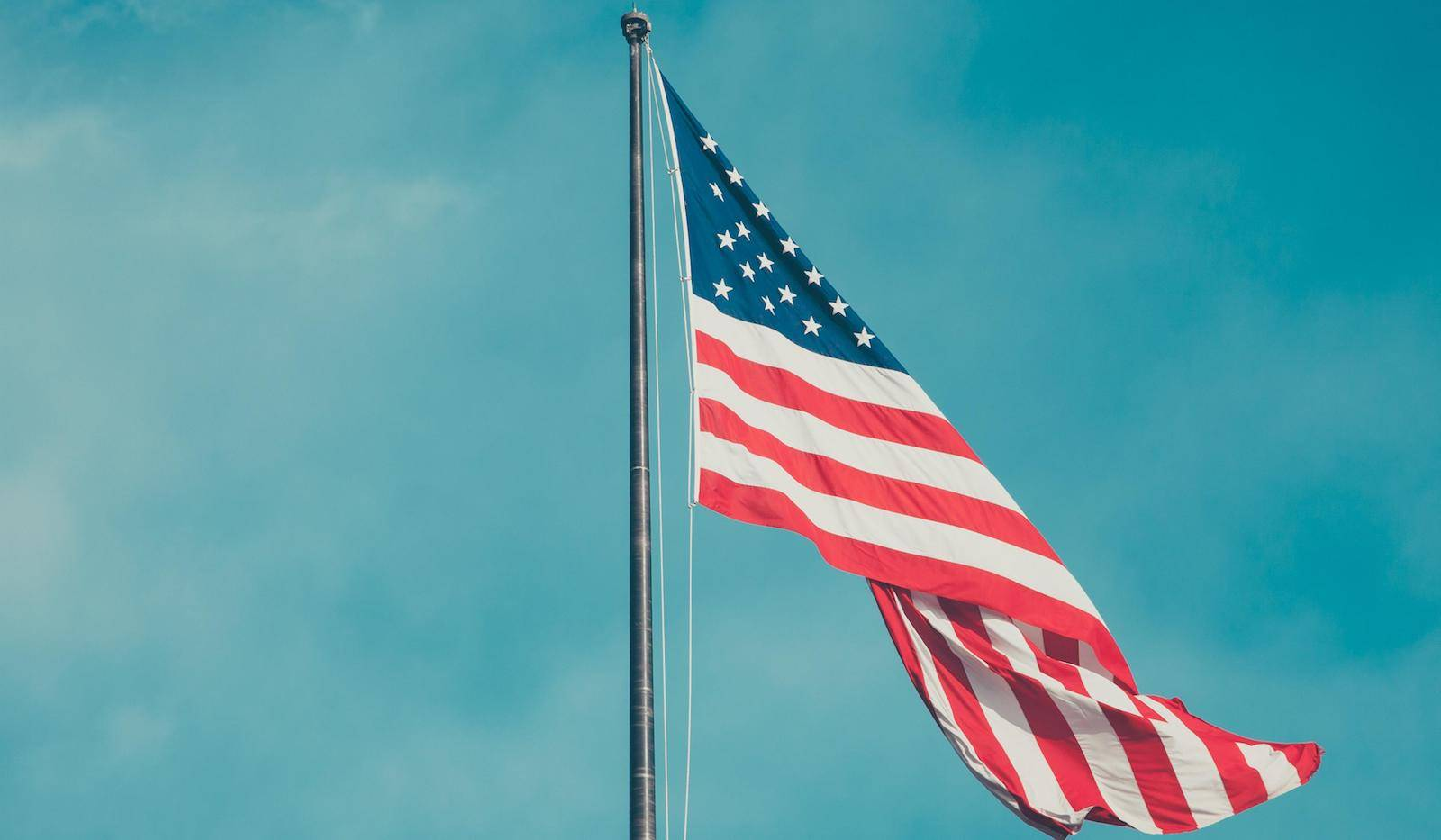 A photo of the American flag waving in the wind.