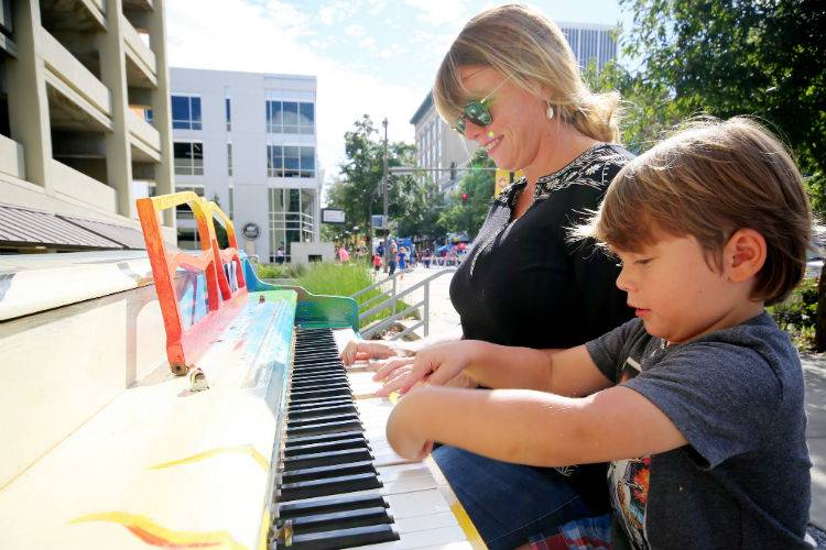 Little Rock-downtown piano-mother and son